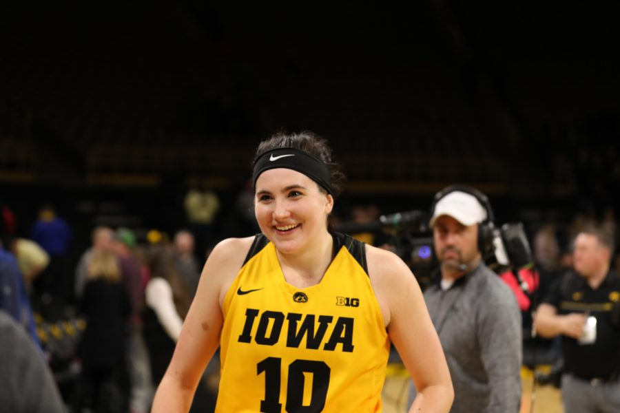 Iowa forward Megan Gustafson smiles as she walks off the court after a basketball game against Michigan State on Thursday, Feb. 7, 2019. The Hawkeyes defeated the Spartans 86-71.