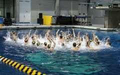 The Iowa swimming and diving teams sing the Iowa fight song after a swim meet against the University of Northern Iowa and Western Illinois University on Friday, Feb. 1.