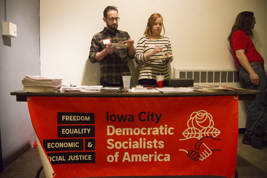 Co-chairs of the Iowa City Tennants Union have a bite to eat during their Fundraiser Concert at Public Space One on Sunday February 10, 2019.