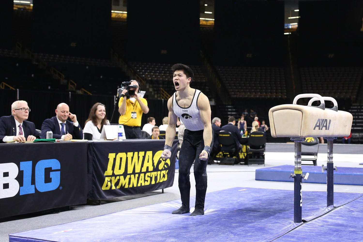 Iowa gymnast Bennet Huang celebrates after dismounting the pommel horse during a gymnastics meet against Minnesota and Illinois-Chicago on Saturday, Feb 2, 2019. The Golden Gophers won the meet with a total score of 406.400 with the Hawkeyes scoring 401.600 and the Flames scoring 355.750.