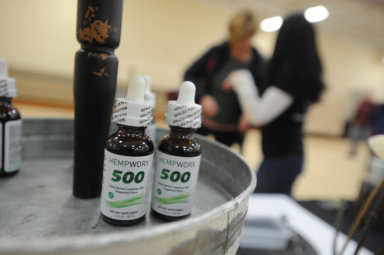 Teressa Sworsky talks with potential customers and explains the benefits of hemp oil and other CBD products at the Mokena Park District's January Flea Market on Jan. 13, 2019 in Mokena, Ill.  (Warren Skalski/Chicago Tribune/TNS)