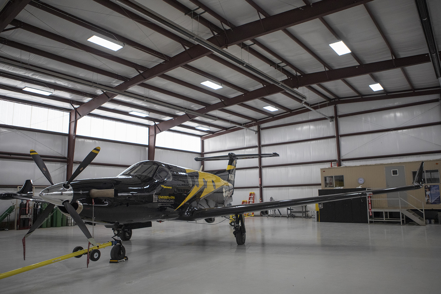 The new University of Iowa Hospitals AirCare plane rests in its hanger on Wednesday, February 20, 2019. This PC-12 was built by Swiss company Pilatus and boasts a Pratt and Whitney PT6 turboprop engine capable of producing over 1900 horsepower.