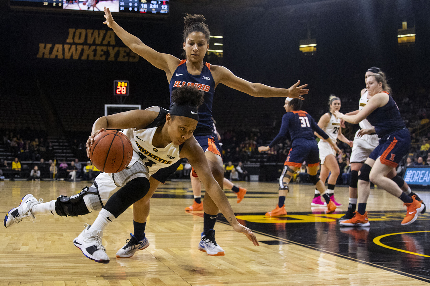 Iowa guard Tania Davis falls while dribbling to the basket during the Iowa/Illinois women's basketball game at Carver-Hawkeye Arena on Thursday, February 14, 2019. The Hawkeyes defeated the Fighting Illini, 88-66.