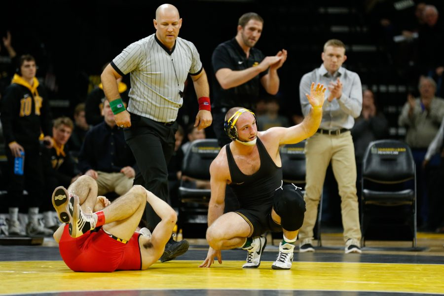Iowa+Wrestler+%232+Alex+Marinelli+waves+to+the+crowd+after+defeating+Maryland+Wrestler+Phillip+Spadafora+in+the+165lb+weight+class+during+a+wrestling+dual+meet+at+Carver-Hawkeye+Arena+on+Friday%2C+Feb.+8%2C+2019.+Marinelli+won+via+pin+at+3%3A50+and+the+Hawkeyes+defeated+the+Terrapins+48-0.+