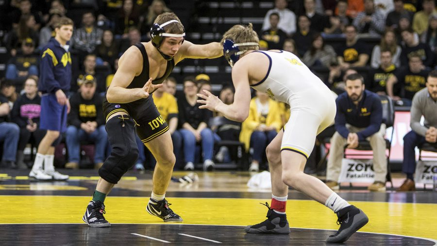Iowa+wrestler+Spencer+Lee+grapples+with+Michigan+wrestler+Drew+Martin+at+Carver-Hawkeye+Arena+on+Saturday%2C+Jan.+27%2C+2018.+