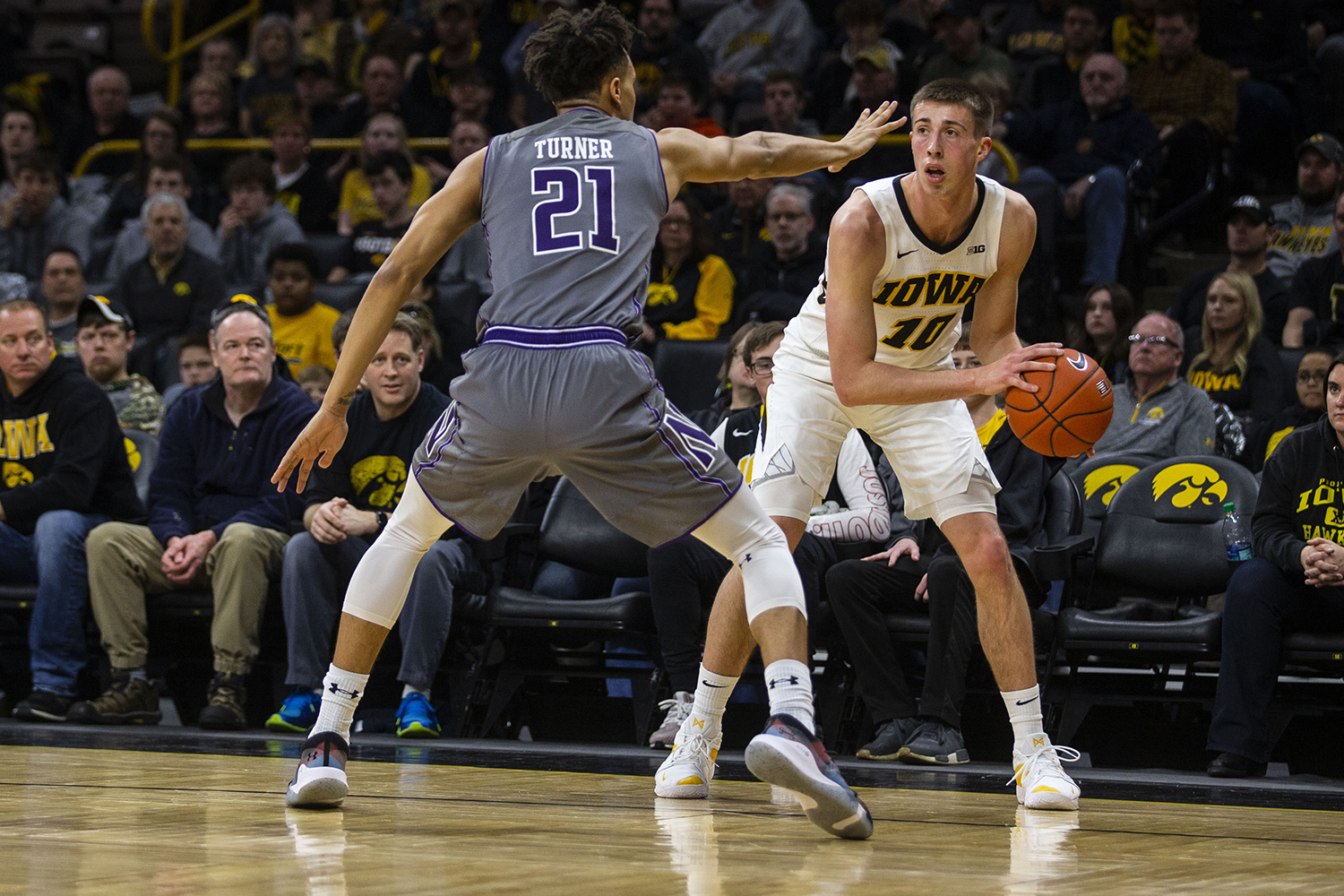 Iowa guard Joe Wieskamp looks to pass the ball during the Iowa/Northwestern men's basketball game at Carver-Hawkeye Arena on Sunday, February 10, 2019. The Hawkeyes defeated the Wildcats, 80-79. (Lily Smith/The Daily Iowan)