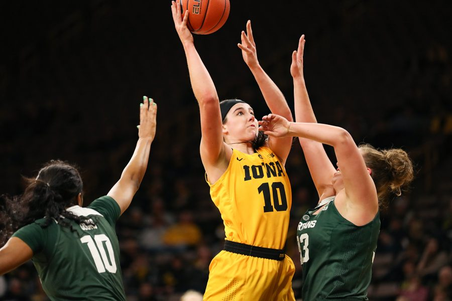 Iowa forward Megan Gustafson (10) fights for a layup during a basketball game against Michigan State on Thursday, Feb. 7, 2019. The Hawkeyes defeated the Spartans 86-71. Gustafson led all scorers with 41 points.