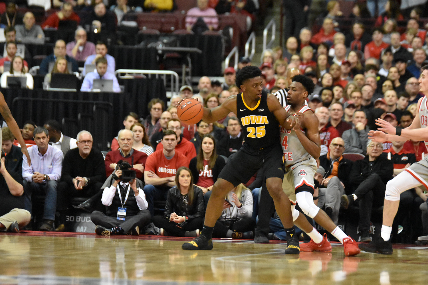 Tyler Cook dribbles in the post during Ohio State's 90-70 win over No. 22 Iowa on Feb. 26 (Cori Wade/The Lantern).