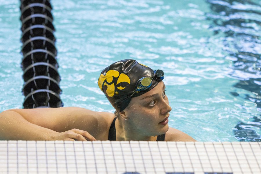Iowa+swimmer+Hannah+Burvill+rests+after+finishing+her+race+during+the+Hawkeye+Invitational+swim+meet+at+the+Campus+Recreation+and+Wellness+Center+on+Thursday+Nov.+15%2C+2018.+