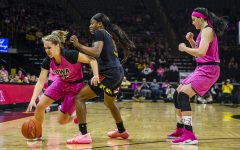 Iowa guard Kathleen Doyle dribbles past Maryland guard Kaila Charles during the women's basketball game vs. Maryland at Carver-Hawkeye Arena on Sunday, February 17, 2019. The Hawkeyes defeated the Terrapins 86-73.