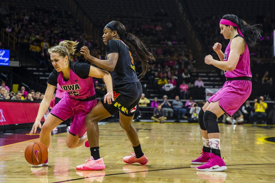 Iowa+guard+Kathleen+Doyle+dribbles+past+Maryland+guard+Kaila+Charles+during+the+women%27s+basketball+game+vs.+Maryland+at+Carver-Hawkeye+Arena+on+Sunday%2C+February+17%2C+2019.+The+Hawkeyes+defeated+the+Terrapins+86-73.+