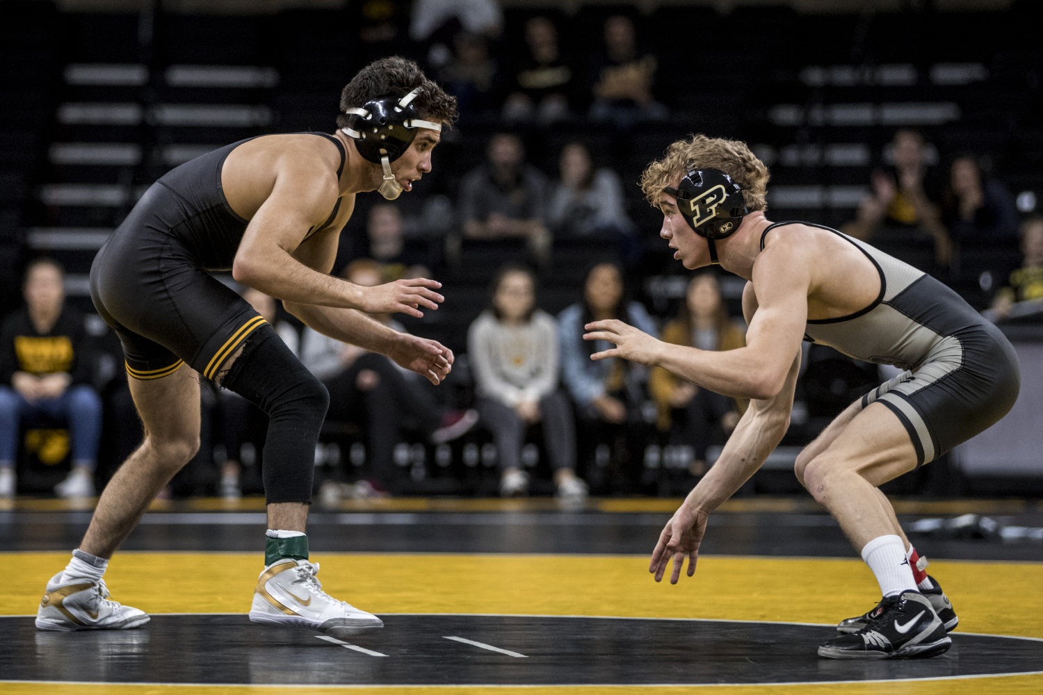Iowa's Perez Perez and Purdue's Devin Schroder wrestle during Iowa's dual meet against Purdue at Carver-Hawkeye Arena in Iowa City on Saturday, November 24, 2018. Schroder defeated Perez by 4-2. The Hawkeyes defeated the Boilermakers 26-9.