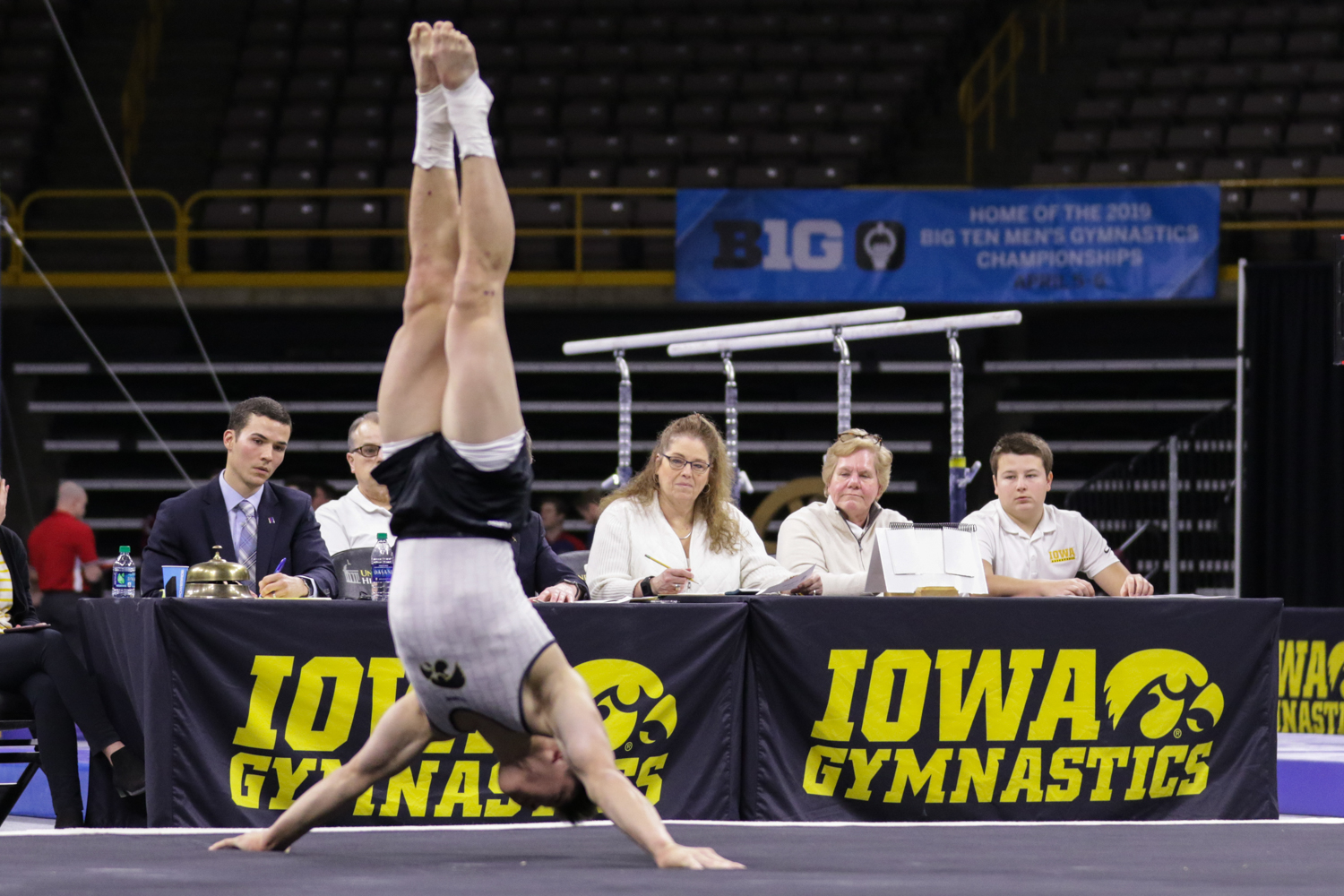 Judges watch Iowa gymnast Bennet Huang perform on the floor during a gymnastics meet against Minnesota and Illinois-Chicago on Saturday, Feb 2, 2019. The Golden Gophers won the meet with a total score of 406.400 with the Hawkeyes scoring 401.600 and the Flames scoring 355.750.