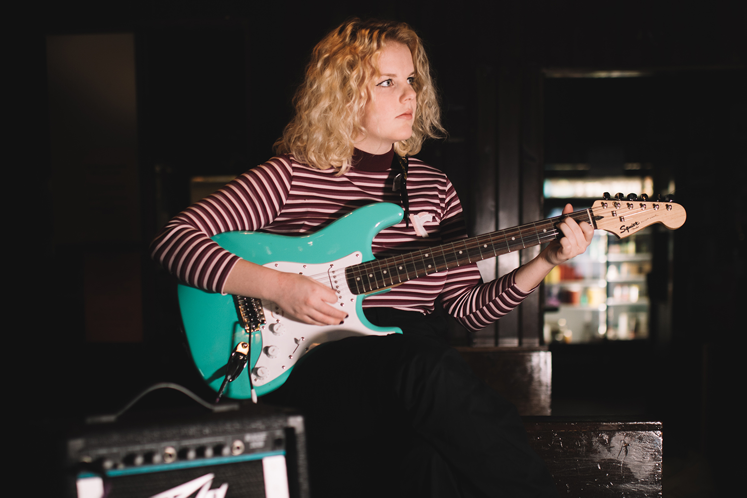 Elly Hofmaier plays her guitar at The Mill-Iowa City on Wednesday, February 27, 2019.