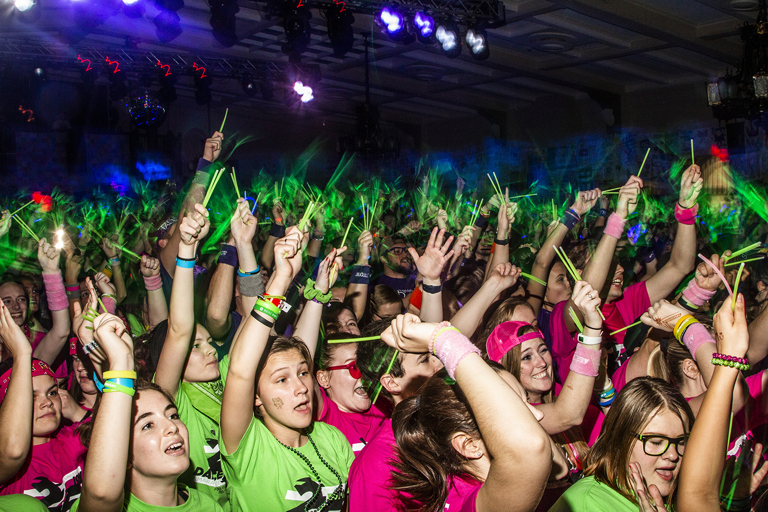 Dancers wave their glow sticks during Power Hour at Dance Marathon 25 at the IMU on Feb. 2.