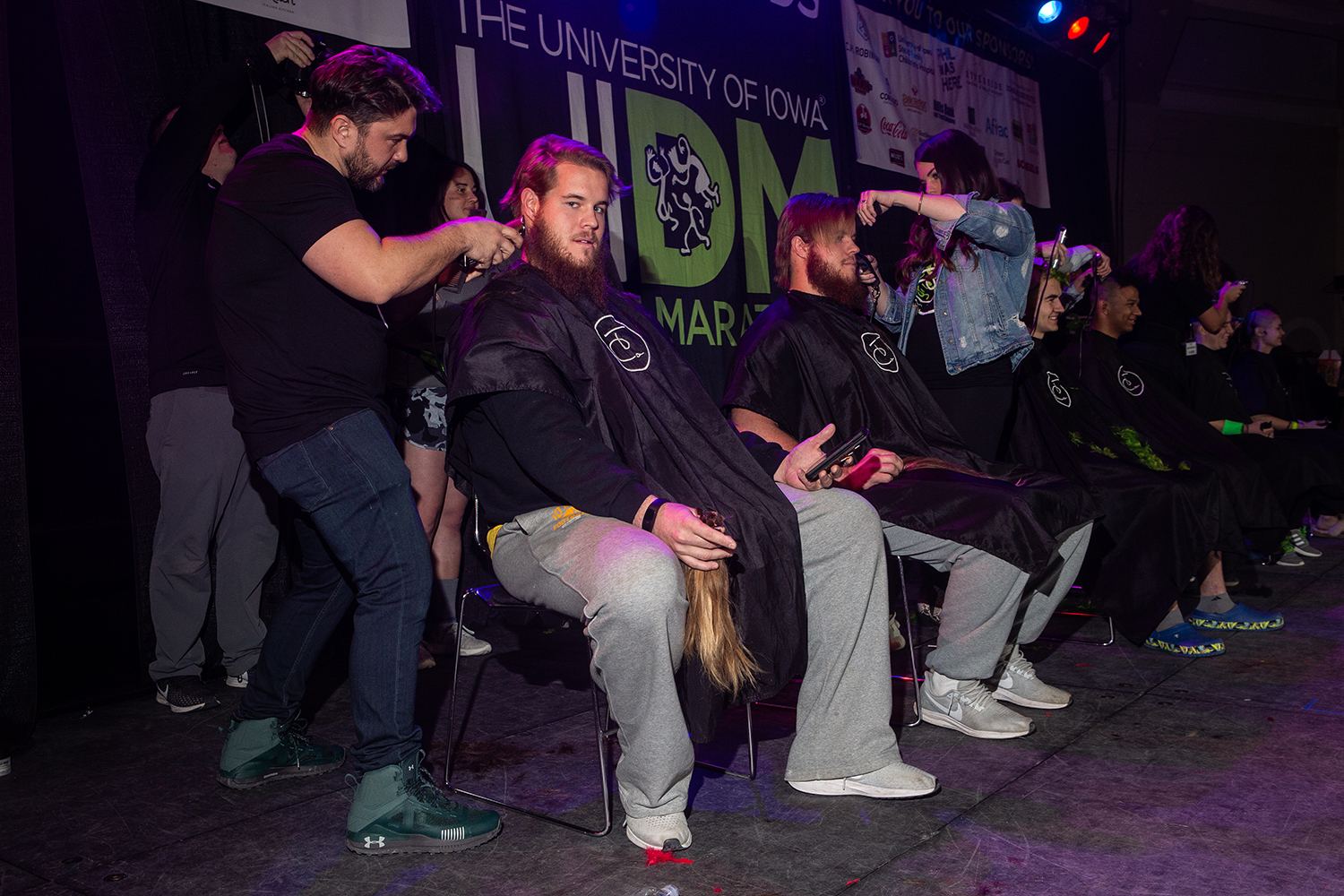 Landan (left) and Levi Paulsen (right) get a trim during Dance Marathon 25 at the Iowa Memorial Union on Saturday, February 2, 2019. After Landan's girlfriend Alexis Henry raised over $10,000 for the Big Event, the twins committed to losing their locks.