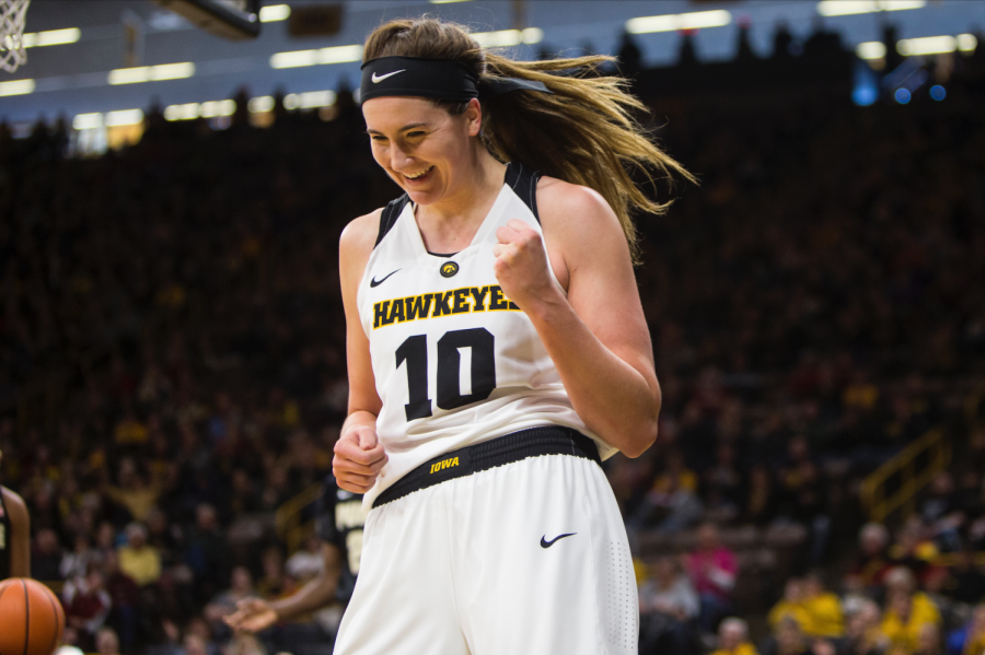 Iowa center Megan Gustafson celebrates after drawing a foul while making a basket during an Iowa/Purdue women's basketball game in Carver-Hawkeye Arena on Saturday, Jan. 13, 2018. The Boilermakers defeated the Hawkeyes, 76-70.