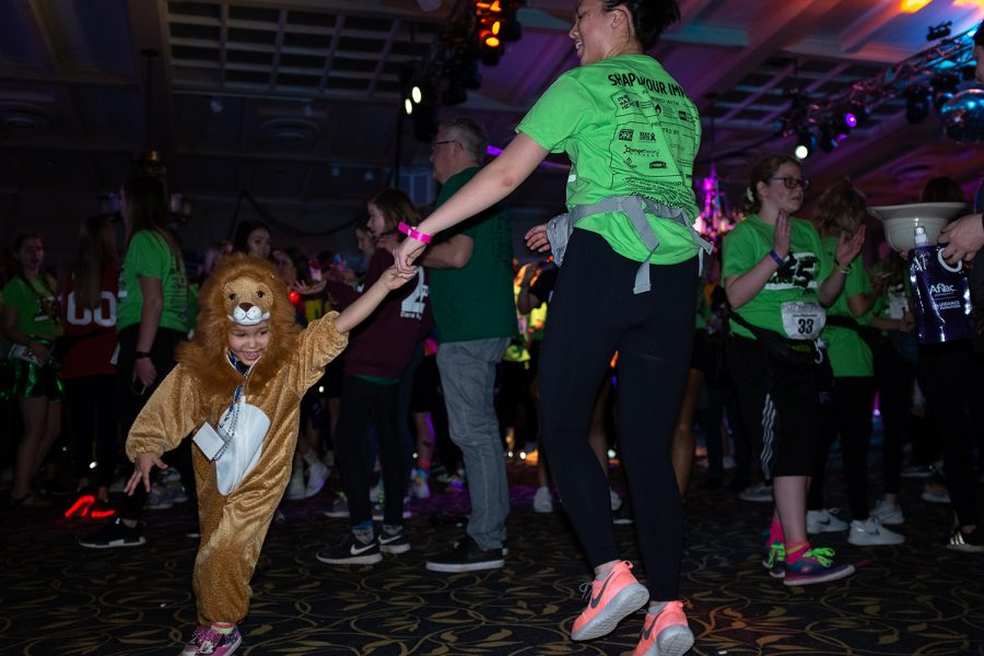 A dancer dressed as a lion busts a move during Dance Marathon 25 at the Iowa Memorial Union on Friday, Feb. 1, 2019. As the Big Event moved into its fourth hour, participants showed no signs of slowing down.