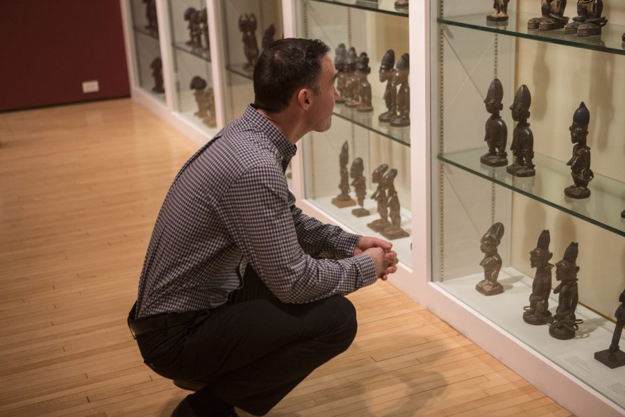 Cory Gundlach, graduate student and art curator, is seen in the Stanley Museum of Arts in the Iowa Memorial Union on Tuesday, February 19, 2019. The Museum holds some of the works of African art that he is studying, by scanning them with a CT scanner to see what is hidden inside. (Grace Colton /The Daily Iowan)