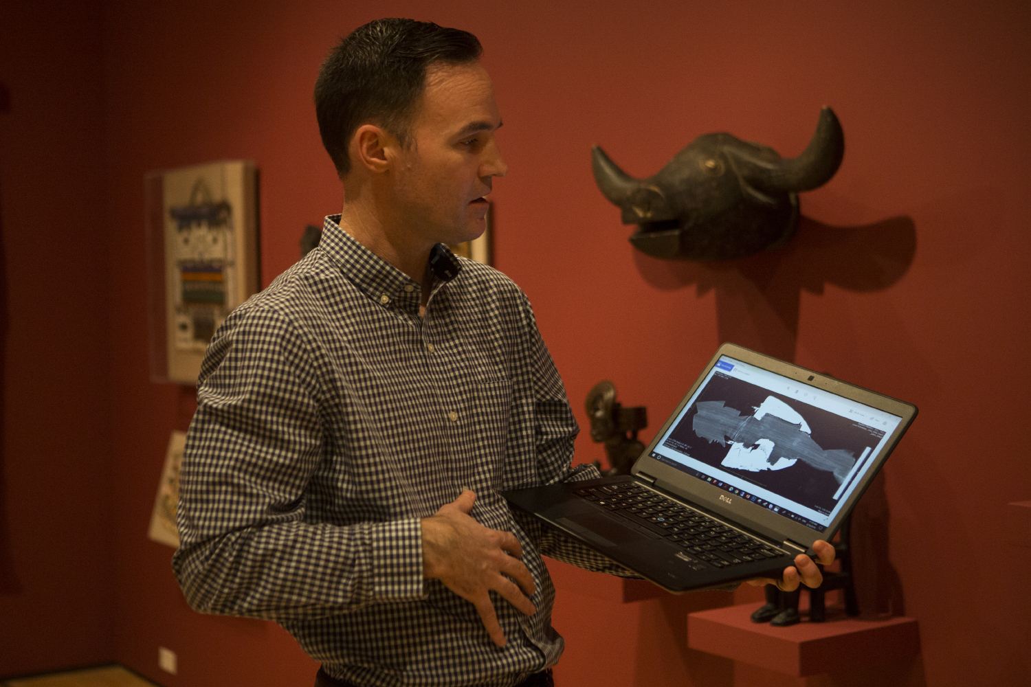Cory Gundlach talks about his findings within works of African Art at the Stanley Museum of Art in the Iowa Memorial Union on February 19 2019. Using a CT scanner at University of Iowa Hospitals and Clinics, Gundlach scanned some of the works to see what might be hidden inside. (Grace Colton /The Daily Iowan)