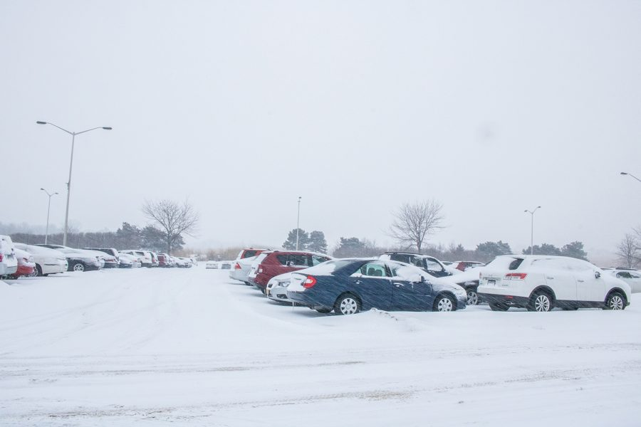 Snow comes down in the Hawk Lot on Monday, February 11, 2019.