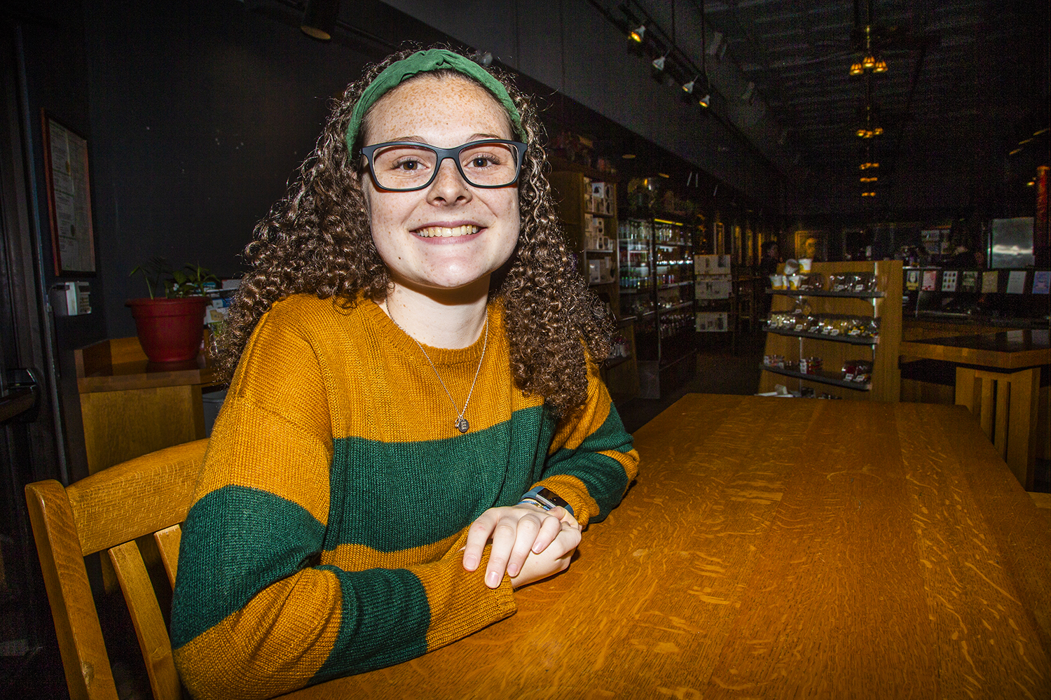 UI junior Ella McDonald poses for a portrait at Java House on Monday, February 11, 2019. McDonald started the