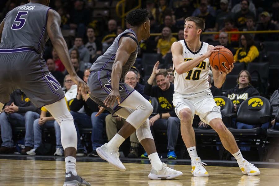Iowa+guard+Joe+Wieskamp+looks+to+pass+the+ball+during+the+Iowa%2FNorthwestern+men%27s+basketball+game+at+Carver-Hawkeye+Arena+on+Sunday%2C+February+10%2C+2019.+The+Hawkeyes+defeated+the+Wildcats%2C+80-79.+