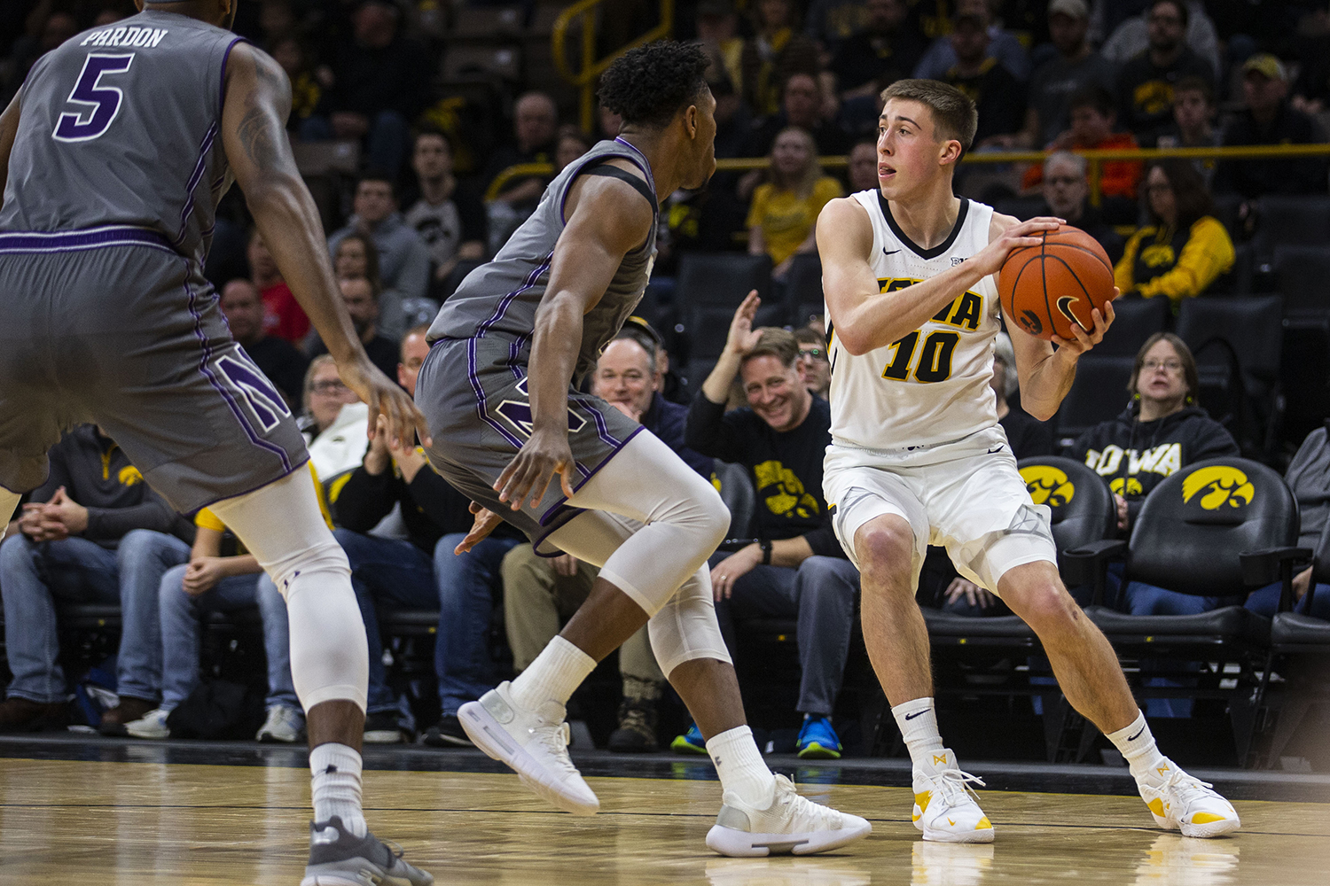 Iowa guard Joe Wieskamp looks to pass the ball during the Iowa/Northwestern men's basketball game at Carver-Hawkeye Arena on Sunday, February 10, 2019. The Hawkeyes defeated the Wildcats, 80-79.