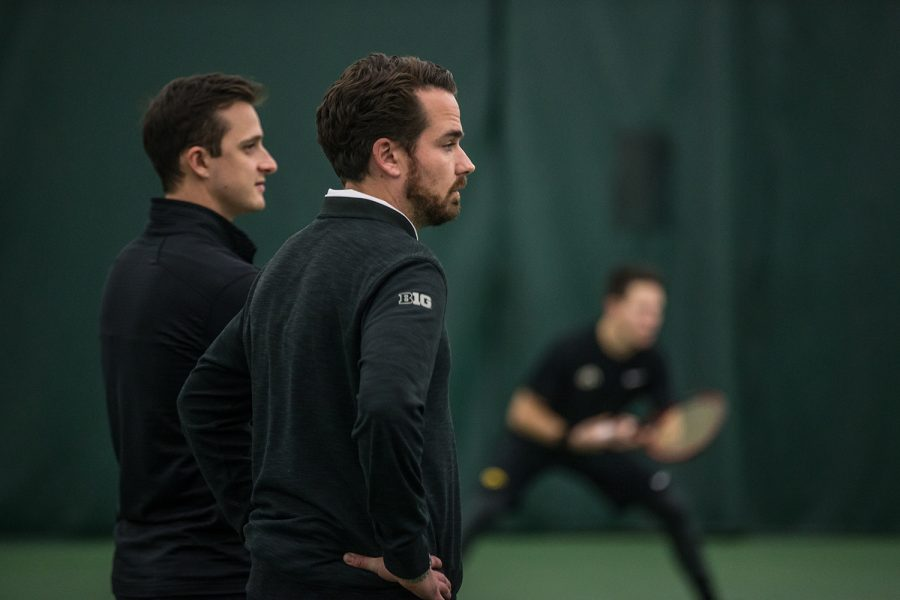 Iowa+coach+Ross+Wilson+watches+his+team+during+a+men%27s+tennis+match+between+Iowa+and+Marquette+on+Saturday%2C+January+19%2C+2019.+The+Hawkeyes+swept+the+Golden+Eagles%2C+7-0.+