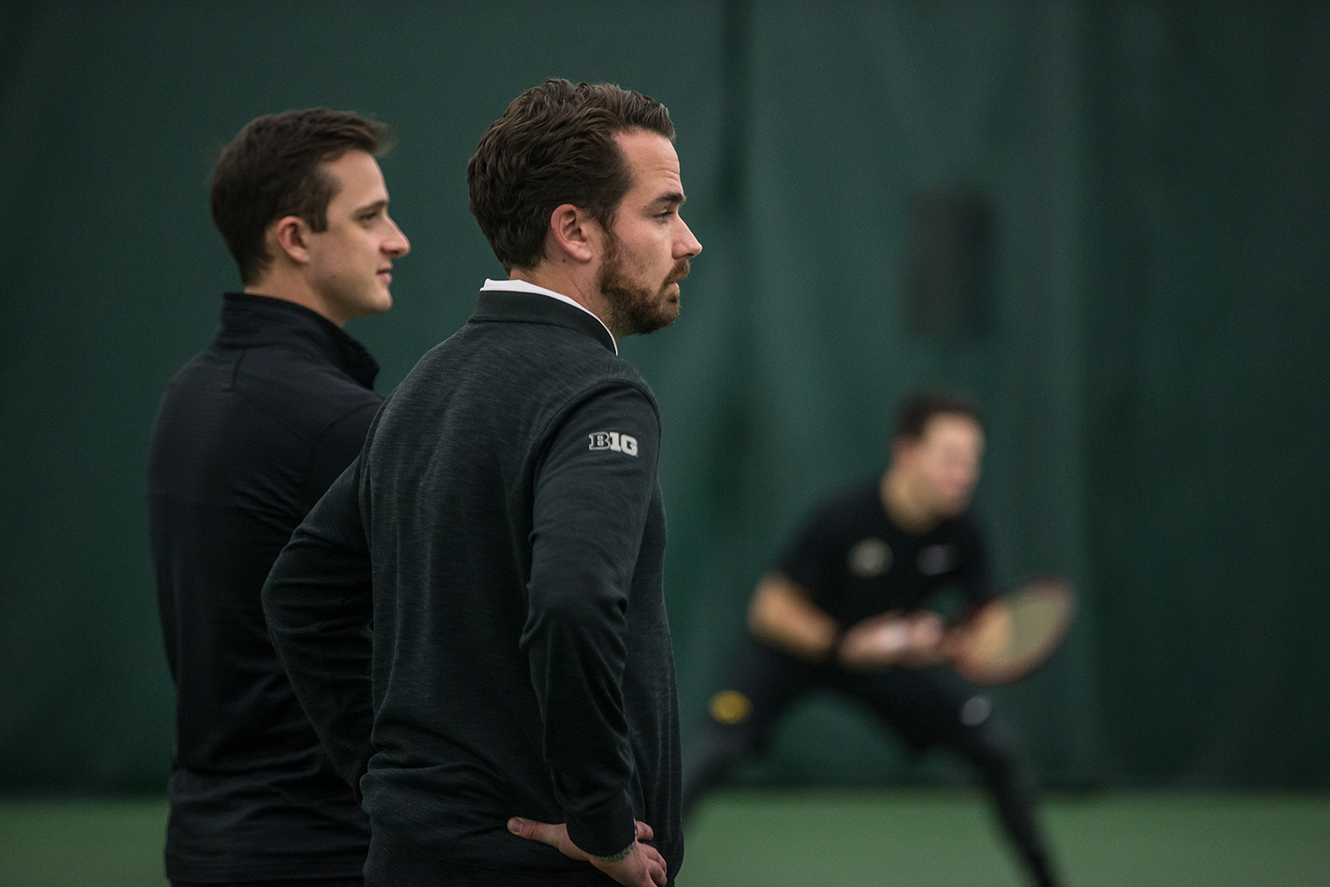 Iowa coach Ross Wilson watches his team during a men's tennis match between Iowa and Marquette on Saturday, January 19, 2019. The Hawkeyes swept the Golden Eagles, 7-0.