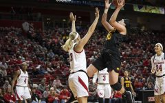 Iowa's Megan Gustafson shoots over Nebraska's Ashtyn Veerbeek during the matchup at Pinnacle Bank Arena on Monday, Feb. 25, 2019, in Lincoln, Nebraska.