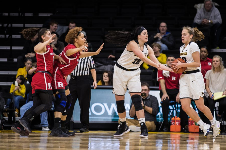 Iowa+forward+Megan+Gustafson+hands+the+ball+to+teammate+Kathleen+Doyle+during+a+women%27s+basketball+matchup+between+Iowa+and+Rutgers+at+Carver-Hawkeye+Arena+on+Wednesday%2C+January+23%2C+2019.+The+Hawkeyes+defeated+the+Scarlet+Knights%2C+72-66.+