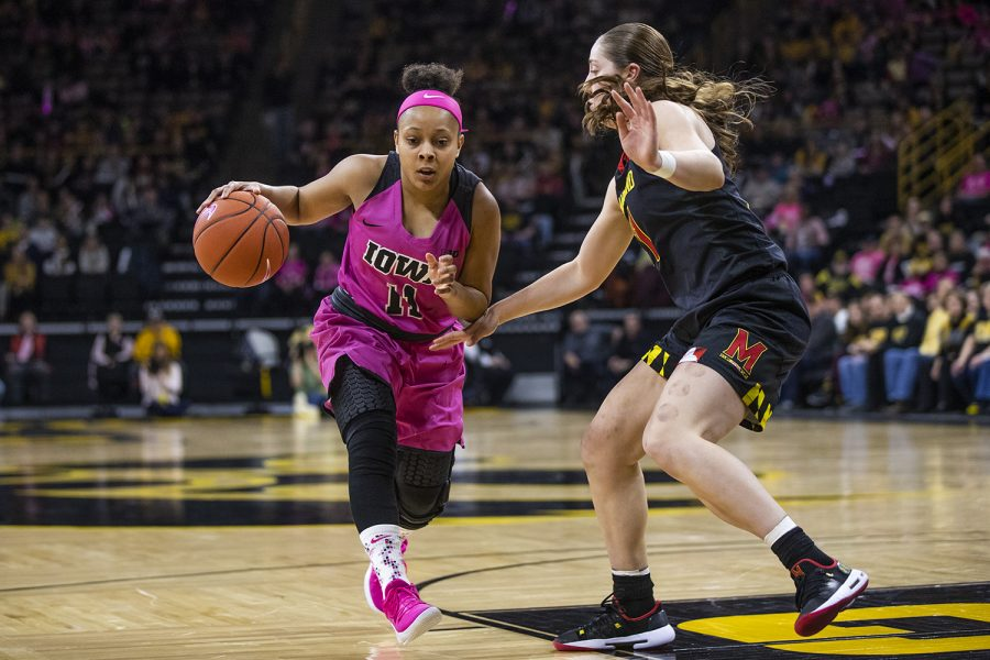 Iowa guard Tania Davis dribbles the ball past Maryland guard Taylor Mikesell during women's basketball vs. Maryland at Carver-Hawkeye Arena on Sunday, February 17, 2019. The Hawkeyes defeated the Terrapins 86-73.