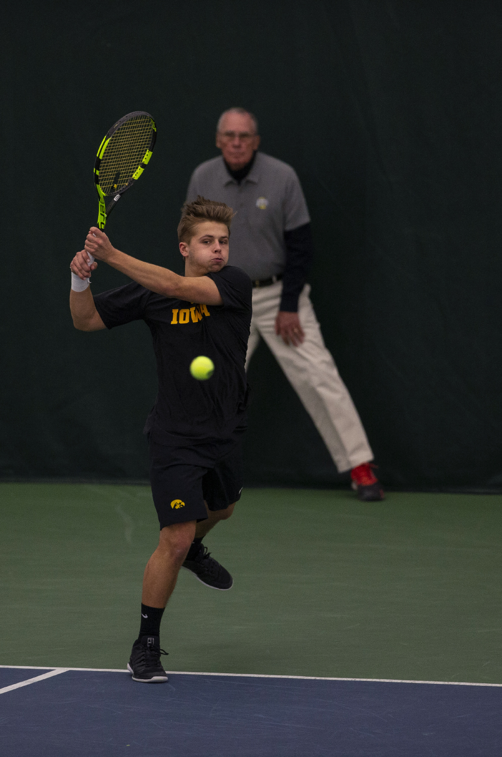 Will+Davies+returns+a+serve+during+the+Men%27s+tennis+match+against+University+of+Miami+at+the+Hawkeye+Tennis+and+Recreation+Complex+on+Feb.+8%2C+2019.+Davies+and+his+partner+Oliver+Okonkwo+defeated+the+Hurricanes+in+their+doubles+match+6-3.+Miami+defeated+Iowa+4-1.+