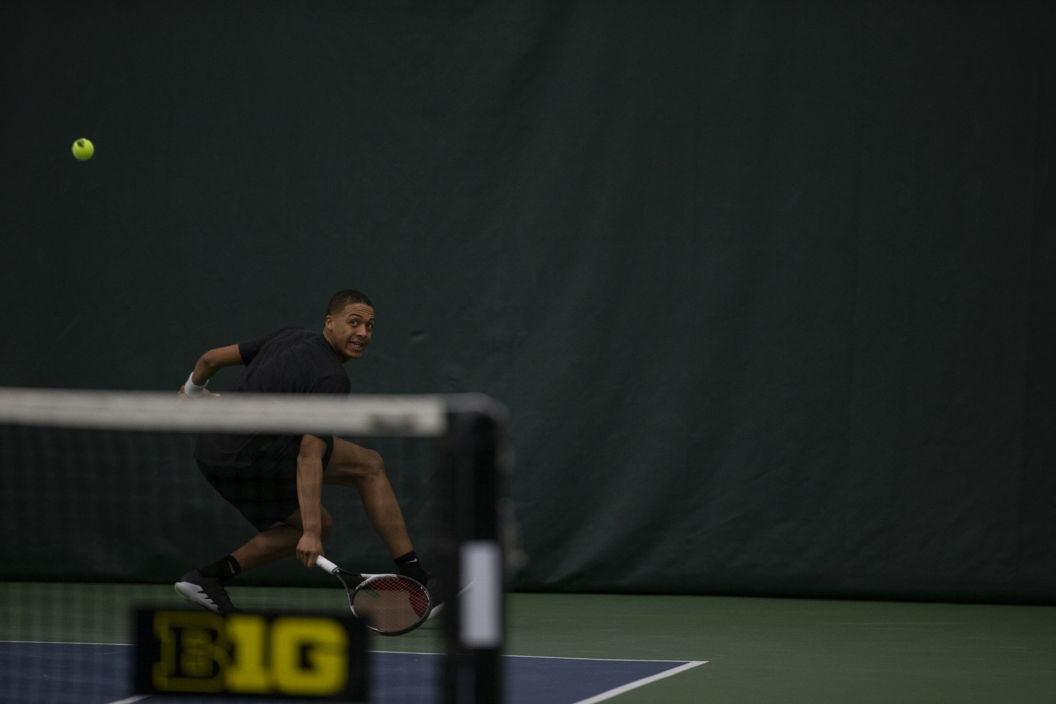 Oliver+Okonkwo+watches+the+ball+during+the+Men%27s+tennis+match+against+University+of+Miami+at+the+Hawkeye+Tennis+and+Recreation+Complex+on+Feb.+8%2C+2019.+Okonkwo+won+his+singles+match+against+Dane+Dunlap.+Miami+defeated+Iowa+4-1.+