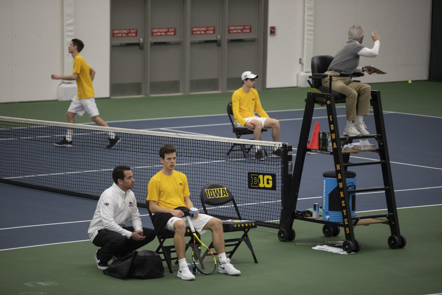 Head+coach+Ross+Wilson+talks+with+Piotr+Smietana+during+the+Men%27s+tennis+match+against+University+of+Utah+at+the+Hawkeye+Tennis+and+Recreation+Complex+on+Feb.+10%2C+2019.+The+Hawkeye+team+defeated+Utah+5-2.+