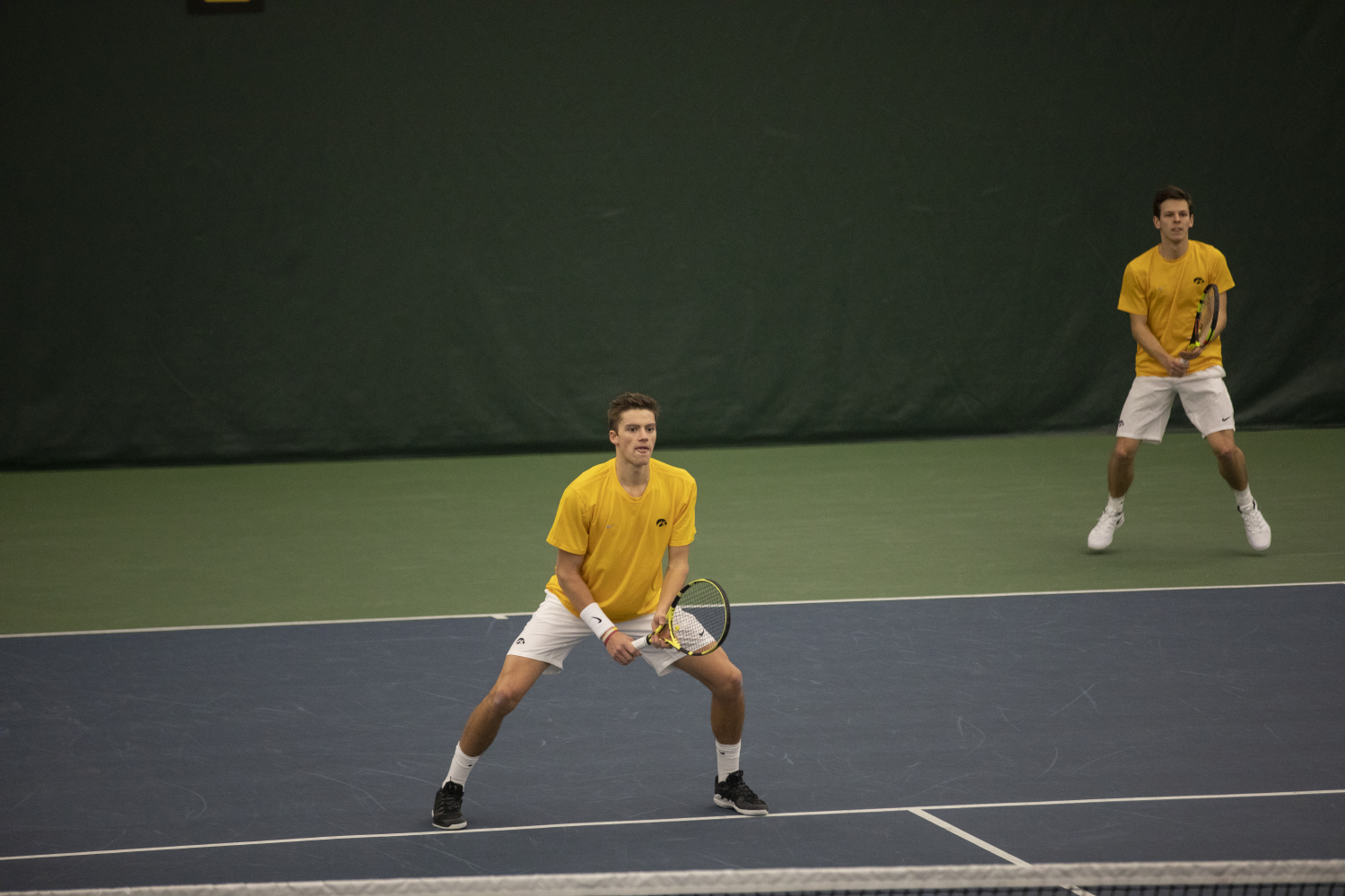 Joe+Tyler+and+Piotr+Smietana+play+a+doubles+match+during+the+Men%27s+tennis+meet+against+University+of+Utah+at+the+Hawkeye+Tennis+and+Recreation+Complex+on+Feb.+10%2C+2019.+The+Hawkeye+team+defeated+Utah+5-2.+