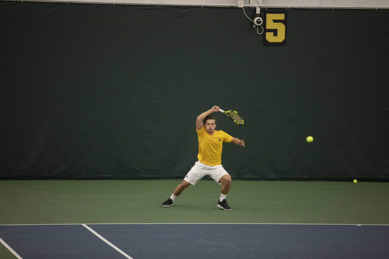 Will+Davies+hits+a+forehand+during+the+Men%27s+tennis+match+against+University+of+Utah+at+the+Hawkeye+Tennis+and+Recreation+Complex+on+Feb.+10%2C+2019.+The+Hawkeye+team+defeated+Utah+5-2.+