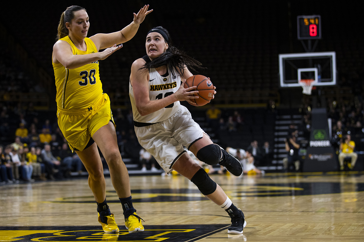 Iowa forward Megan Gustafson drives to the basket during the Iowa/Michigan women's basketball game at Carver-Hawkeye Arena on Thursday, January 17, 2018. The Hawkeyes defeated the Wolverines, 75-61.