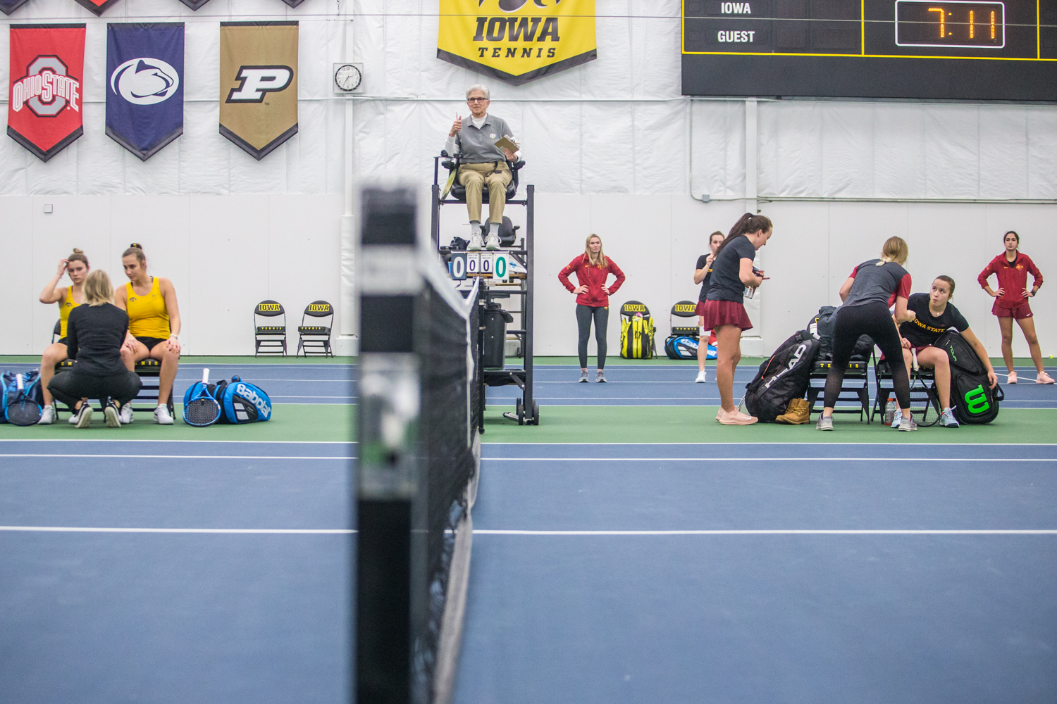 Coaches+speak+with+their+players+during+a+women%27s+tennis+matchup+between+Iowa+and+Iowa+State+at+the+Hawkeye+Tennis+and+Recreation+Complex+on+Friday%2C+February+8%2C+2019.++The+Hawkeyes+dropped+the+doubles+point+but+swept+singles+matches%2C+defeating+the+Cyclones+4-1.
