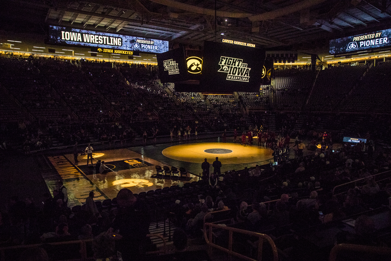 Lights+are+dimmed+during+a+wrestling+match+between+Iowa+and+Indiana+at+Carver-Hawkeye+Arena+on+Friday%2C+February+15%2C+2019.+The+Hawkeyes%2C+celebrating+senior+night%2C+defeated+the+Hoosiers+37-9.