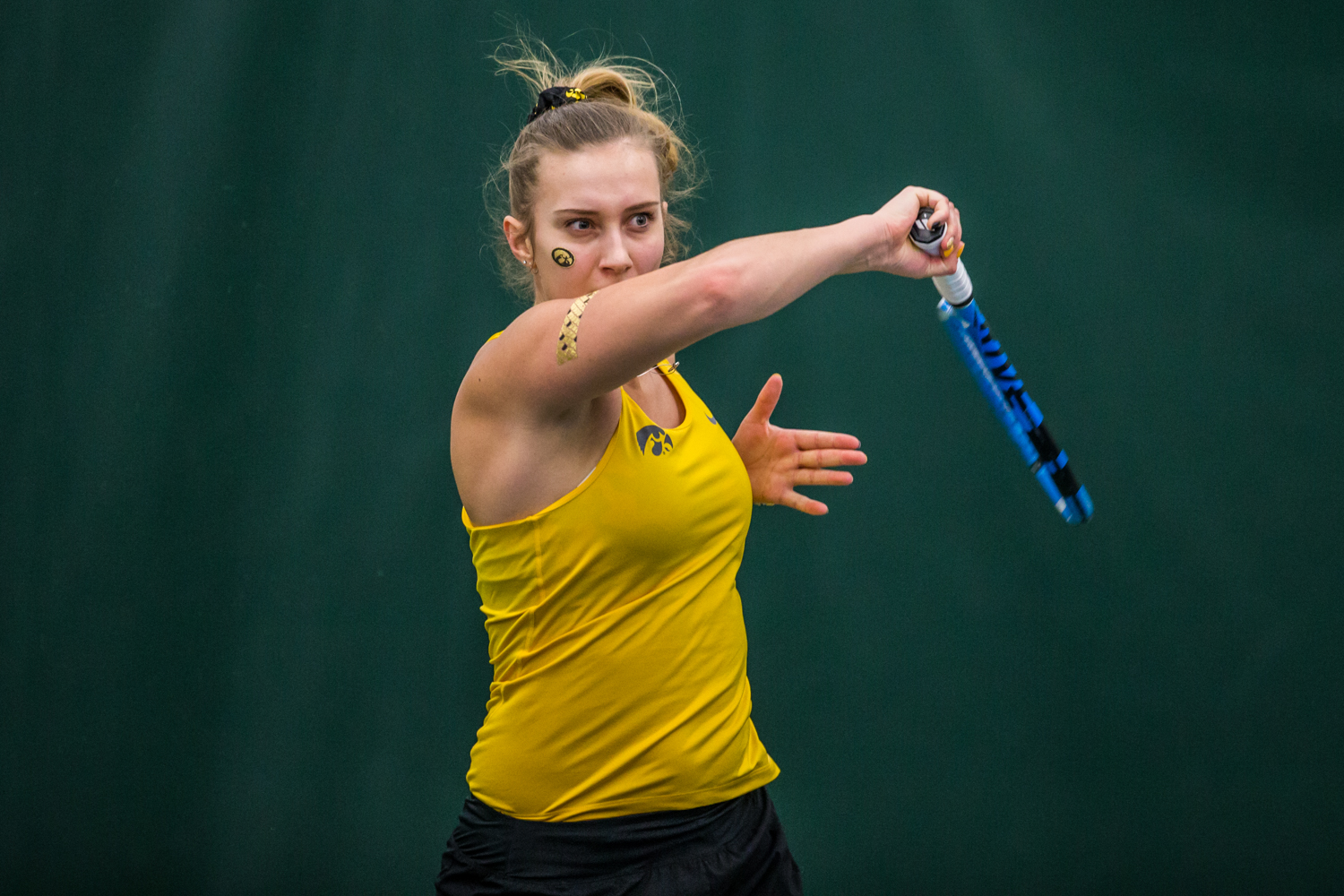 Iowa%27s+Ashleigh+Jacobs+hits+a+forehand+during+a+women%27s+tennis+matchup+between+Iowa+and+Iowa+State+at+the+Hawkeye+Tennis+and+Recreation+Complex+on+Friday%2C+February+8%2C+2019.++The+Hawkeyes+dropped+the+doubles+point+but+swept+singles+matches%2C+defeating+the+Cyclones+4-1.