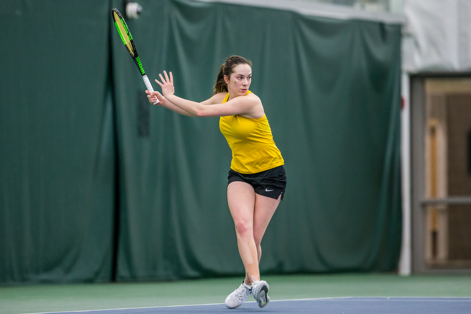 Iowa%27s+Samantha+Mannix+hits+a+forehand+during+a+women%27s+tennis+matchup+between+Iowa+and+Iowa+State+at+the+Hawkeye+Tennis+and+Recreation+Complex+on+Friday%2C+February+8%2C+2019.++The+Hawkeyes+dropped+the+doubles+point+but+swept+singles+matches%2C+defeating+the+Cyclones+4-1.