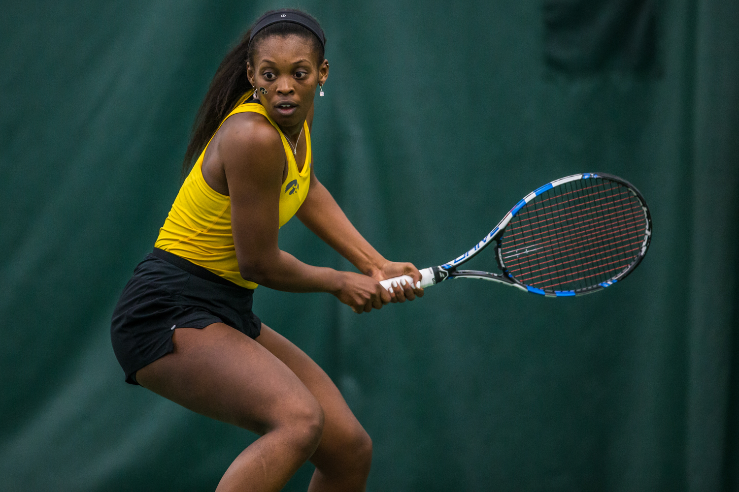 Iowa's Adorabol Huckleby hits a backhand during a women's tennis matchup between Iowa and Iowa State at the Hawkeye Tennis and Recreation Complex on Friday, February 8, 2019.  The Hawkeyes dropped the doubles point but swept singles matches, defeating the Cyclones 4-1.