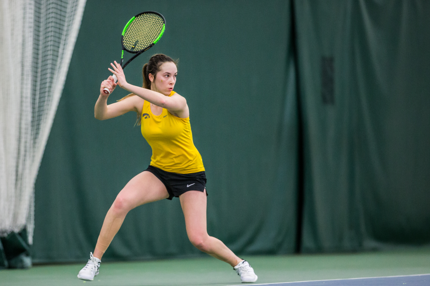 Iowa's Samantha Mannix hits a forehand during a women's tennis matchup between Iowa and Iowa State at the Hawkeye Tennis and Recreation Complex on Friday, February 8, 2019.  The Hawkeyes dropped the doubles point but swept singles matches, defeating the Cyclones 4-1.