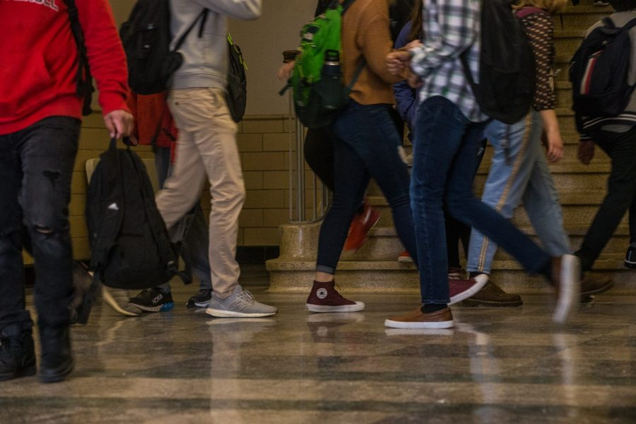 Students traverse a hallway at Iowa City High School on Wednesday, February 13, 2019.