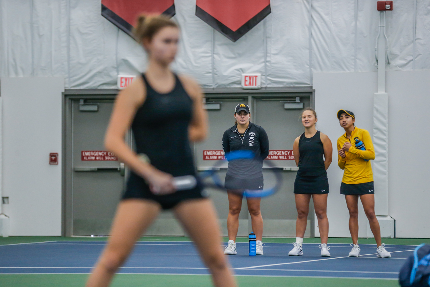 Iowa+players+watch+doubles+matches+during+a+women%27s+tennis+match+between+Iowa+and+Depaul+at+the+Hawkeye+Tennis+and+Recreation+Complex+on+Saturday%2C+February+9%2C+2019.+The+Hawkeyes+defeated+the+Blue+Demons%2C+6-1.