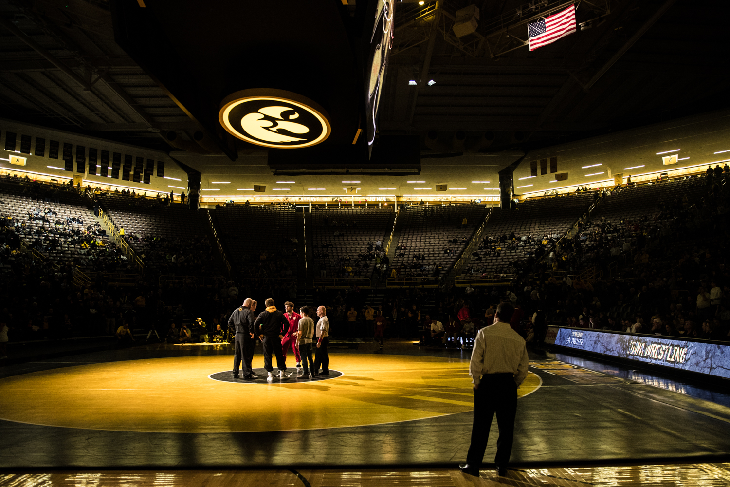Team+captains+convene+on+the+mat+during+a+wrestling+match+between+Iowa+and+Indiana+at+Carver-Hawkeye+Arena+on+Friday%2C+February+15%2C+2019.+The+Hawkeyes%2C+celebrating+senior+night%2C+defeated+the+Hoosiers+37-9.