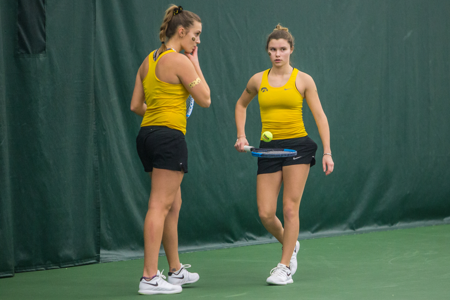 Iowa%27s+Cloe+Ruette+%28right%29+and+Ashleigh+Jacobs+converse+during+a+women%27s+tennis+matchup+between+Iowa+and+Iowa+State+at+the+Hawkeye+Tennis+and+Recreation+Complex+on+Friday%2C+February+8%2C+2019.++The+Hawkeyes+dropped+the+doubles+point+but+swept+singles+matches%2C+defeating+the+Cyclones+4-1.