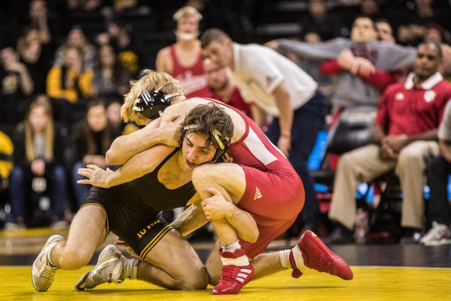 Iowa%27s+No.+3+Austin+DeSanto+wrestles+Indiana%27s+Paul+Konrath+at+133lb+during+a+wrestling+match+between+Iowa+and+Indiana+at+Carver-Hawkeye+Arena+on+Friday%2C+February+15%2C+2019.+The+Hawkeyes%2C+celebrating+senior+night%2C+defeated+the+Hoosiers+37-9.